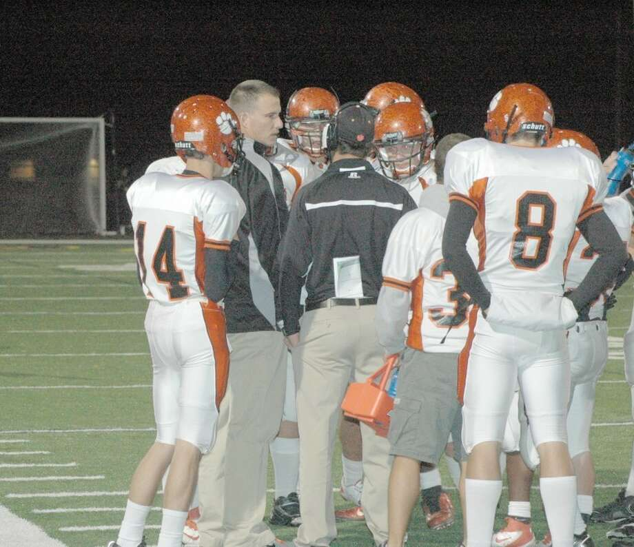 Tiger coach Matt Martin, center, instructs his team during Friday's game at O'Fallon. EHS is looking to qualify for the postseason with a win over Collinsville at 7 p.m. tonight.