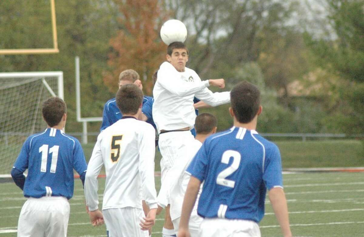 Metro-East Lutheran's Michael Babcock bumps a header at midfield Wednesday at the District 7 Sports Complex vs. Columbia during semifinal action of the Class 1A MELHS Sectional.