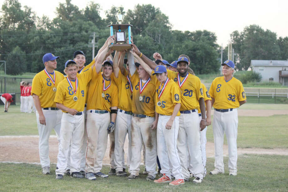 The Edwardsville Post 199 baseball team celebrates with the first-place trophy after winning the District 22 North Division Tournament with a win over Highland on Tuesday in Bethalto. Photo: Photo Submitted For The Intelligencer