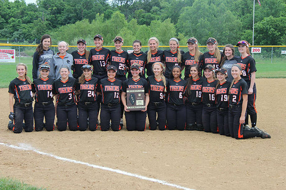 The Edwardsville softball team poses with its Class 4A regional trophy after beating Alton 11-1 on Monday.