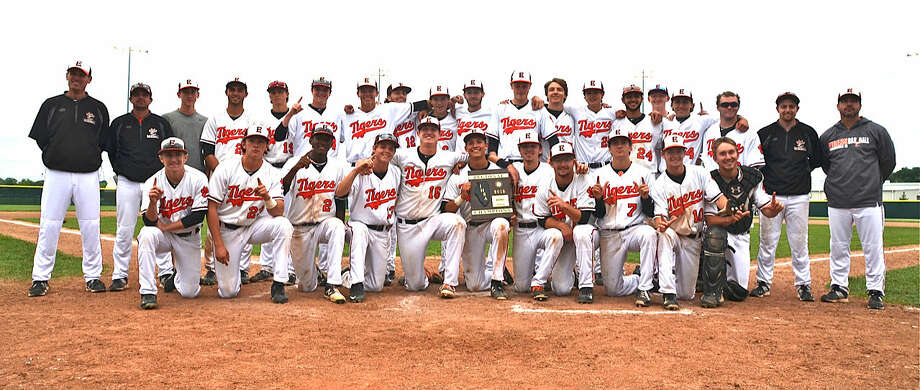 The Edwardsville baseball team poses with the championship plaque after beating Southwestern Conference rival Alton 5-2 Monday in the finals of the Class 4A Edwardsville Regional. Photo: For The Intelligencer