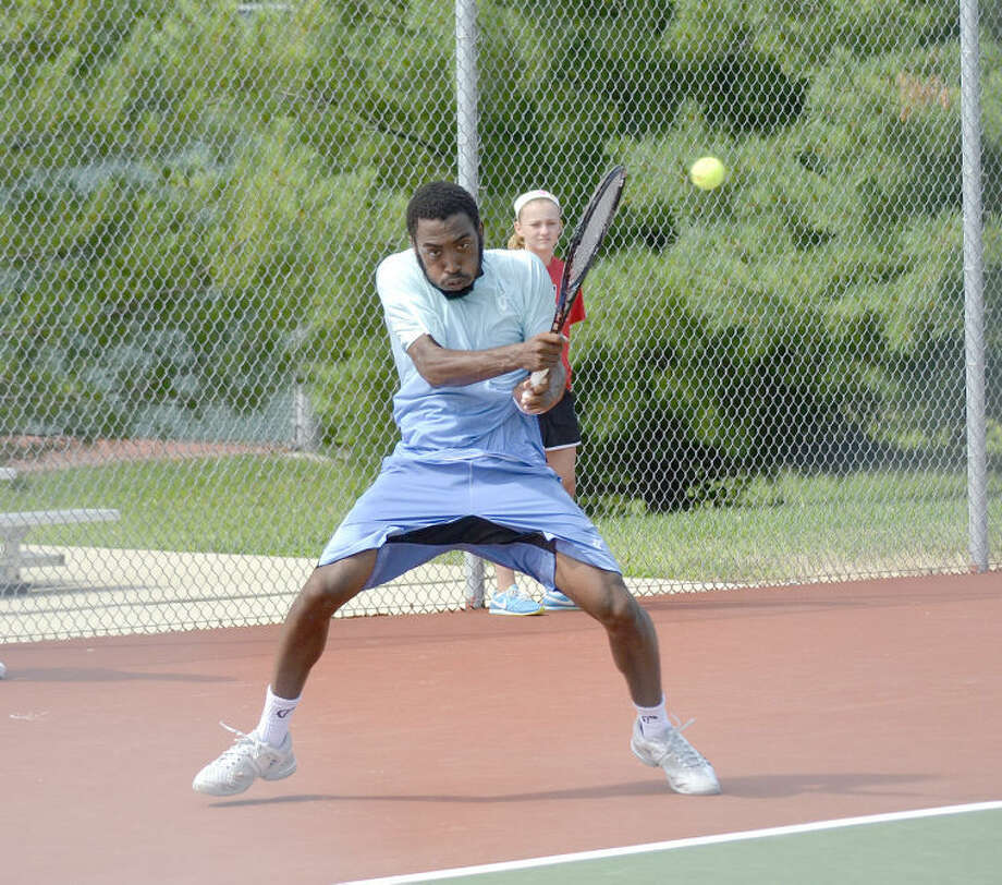 Evan King hits a shot during his quarterfinal match against Eric Quigley at the USTA Edwardsville Futures on Friday.