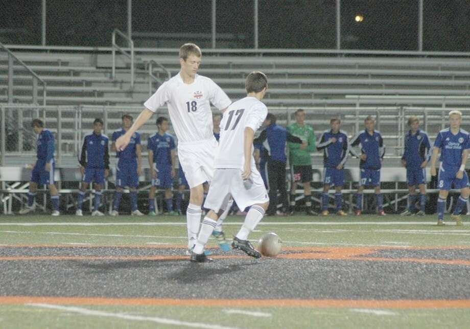 Edwardsville's Chris Pearson, left, and Frank Verdu, right, prepare to start the game on Saturday at the District 7 Sports Complex. EHS lost to Quincy 3-2 in penalty kicks.
