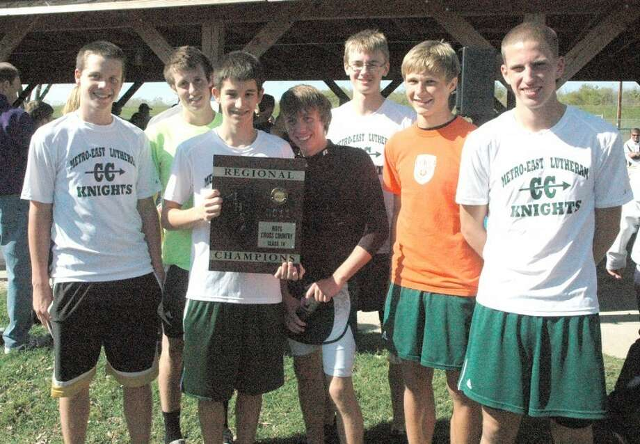 The Metro-East Lutheran Knight boys' cross country team poses with their Class 1A New Athens Regional championship plaque Saturday in New Athens. The Knights edged Freeburg by one point to win. Pictured in front from left to right are: Chase Keirn, Jace Dumont, Aaron Winenger, Derick Benning and Dan Dixon. In back from left to right are: Evan Winenger and Alex Engelbrecht. The Knights will now attempt to capture a sectional crown at SIUE on Saturday in the MELHS Sectional.