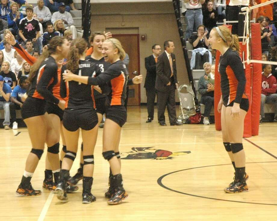 The Edwardsville Tigers celebrate Thursday after beating Quincy to win the Class 4A Granite City Regional.