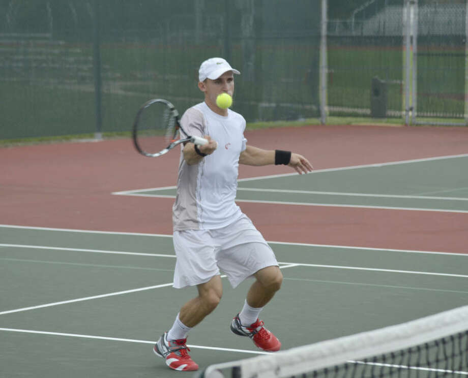 Dimitar Kutrovsky hits a shot at the net during his match at the USTA Edwardsville Futures on Thursday.