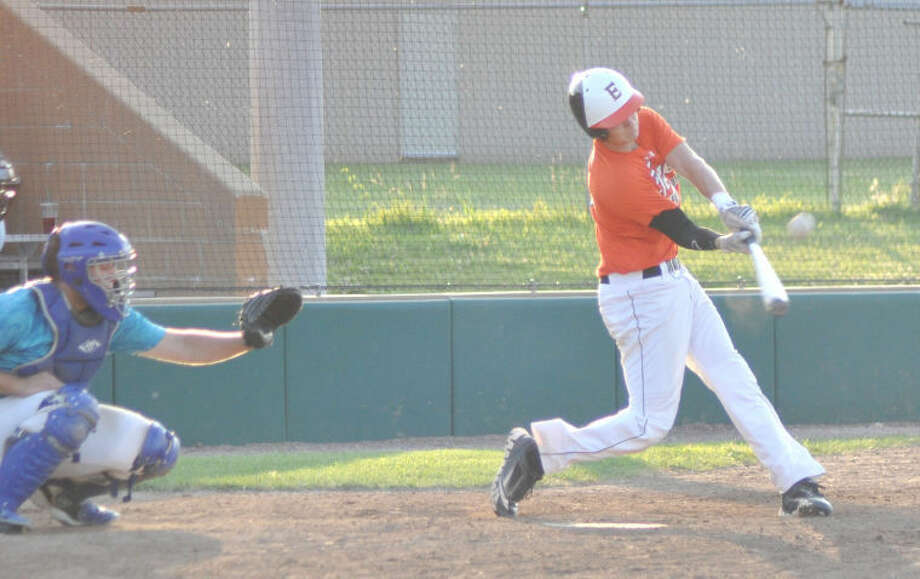Edwardsville's Tyler Stamer connects with a pitch against the Springfield Tribe on Friday at Tom Pile Field.