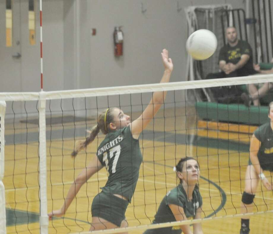 Metro-East Lutheran's McKenna Judge tips a ball over the net during the first game against Nokomis at Thomas Hooks Gymnsaium on Tuesday. MELHS lost in three games.
