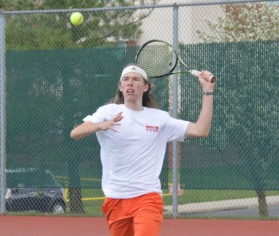 Edwardsville's Erik Weiler charges the net.