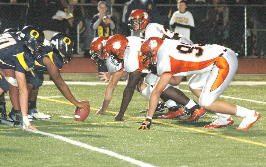 The Edwardsville Tiger defensive front, right, will have its hands full Friday when the Tigers travel to O'Fallon for the first round of the 2011 football playoffs.