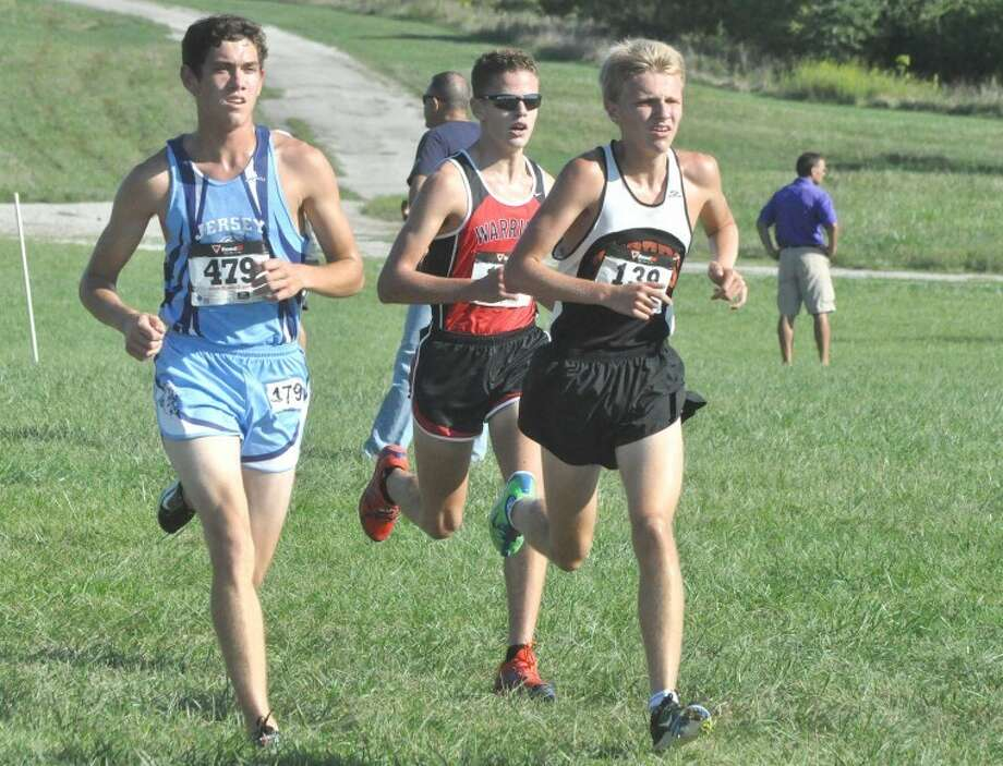 Edwardsville Tiger Brydon Groves-Scott, right, runs in the 29th Annual Tiger Fall Classic at SIUE on Wednesday. Groves-Scott helped the EHS boys' nab the team title by finishing second overall in the race.