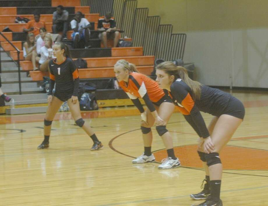 EHS' back line prepares for a serve from St. Joseph's on Wednesday at Lucco-Jackson Gymnasium. Pictured left to right are Tessa Wagner, Katie Shashack and Nicole Allaria.