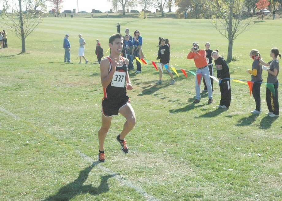 Edwardsville's Garrett Sweatt is only a few strides away from a sectional title at the Class 3A Quincy Sectional on Saturday.