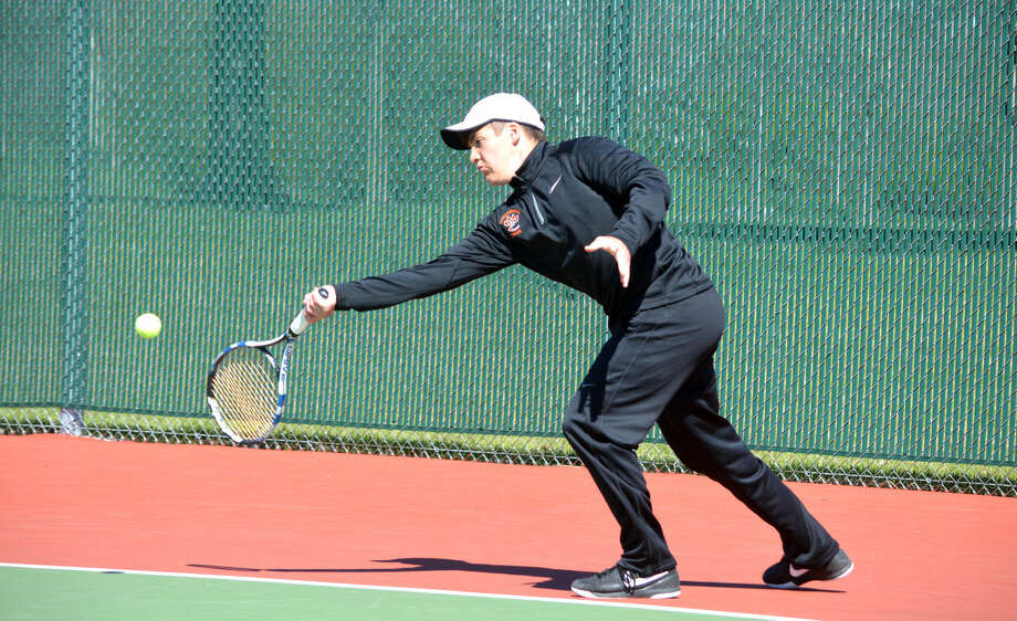 Edwardsville sophomore Seth Lipe returns a shot during his No. 5 singles match against Downers Grove South Saturday at the Edwardsville Invitational.