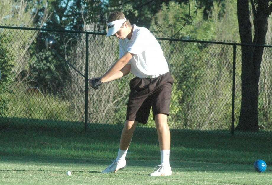 Edwardsville sophomore Ty Zeller prepares to tee off at No. 1 at Oak Brook Golf Club on Monday against Collinsville.