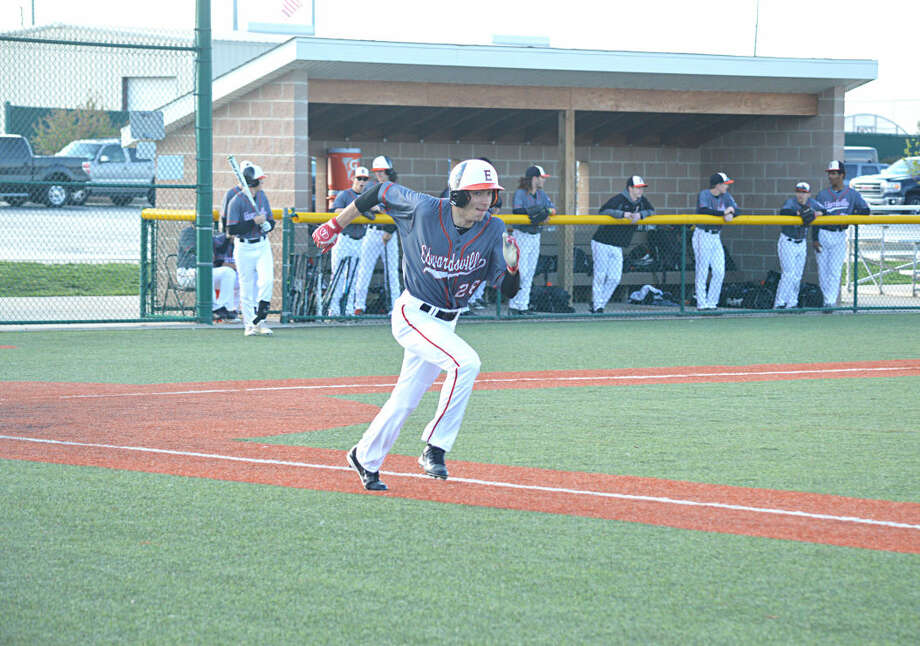 Edwardsville senior Isaac Accola runs to first after hitting a ball to left field.