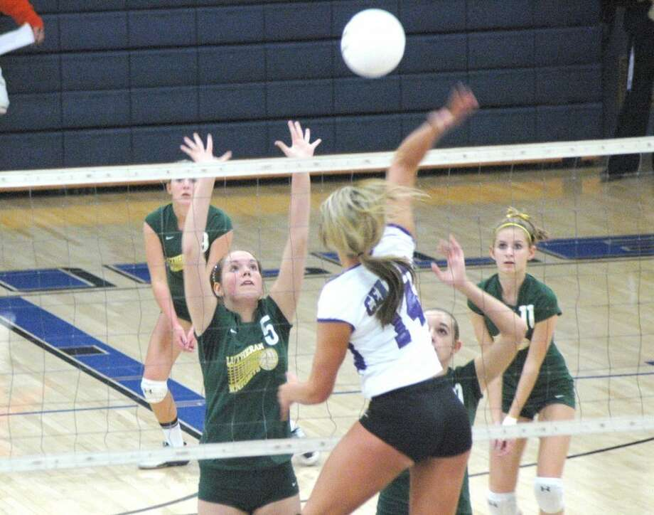 Metro-East Lutheran's Anna Kellar (5) goes up for a block on Breese Central's Taylor Voss (14) during the Class 2A Greenville Sectional semifinals Tuesday.