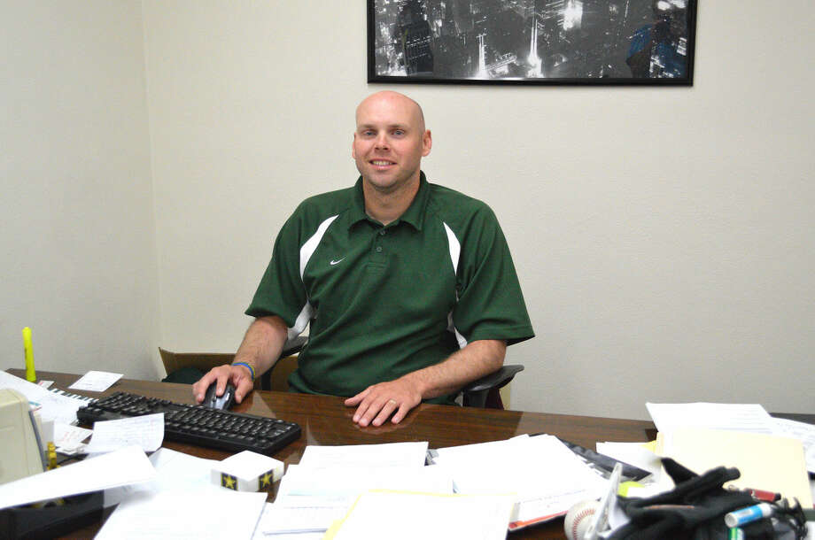 Rob Stock works at his office at Metro-East Lutheran. Stock, who had been the assistant athletic director, is taking over for Dave Redden, who is retiring as athletic director at the end of this month. Stock is also an assistant principal and coaches softball and girls' basketball.