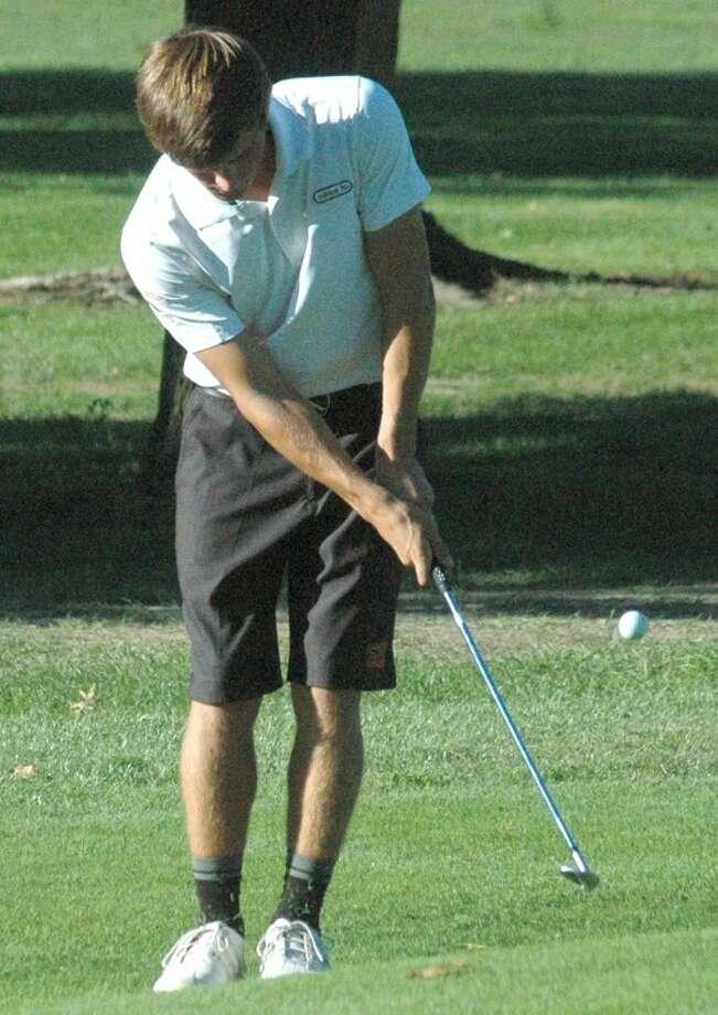 Edwardsville's Connor Bradley hits a chip shot on No. 7 Tuesday vs. Belleville West at Oak Brook Golf Club.