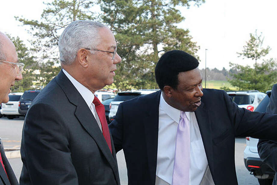 Dr. Ed Hightower, right, leads Ret. Gen. Colin Powell into SIUE's Morris University Center Thursday prior to the inaugural Mannie Jackson Center for the Humanities Foundation dinner. Photo: Bill Tucker/Intelligencer
