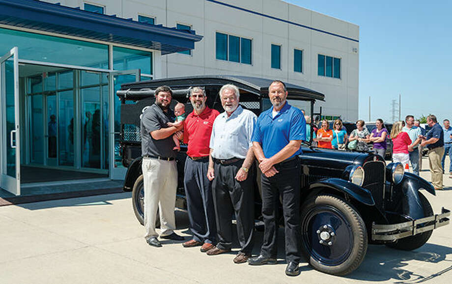 Charlie Fowler, Jim Fowler, Greg Fowler, Jett Fowler and Jonathan Fowler stand in front of a replica of a 1924 Dodge Screen Side Truck. The truck was restored and made into a replica of The Fowler Company's first ever work truck. Photo: Matt Winte/Intelligencer