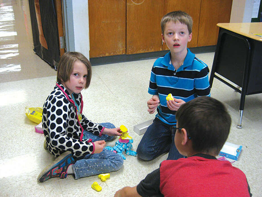 Colleen Moore and Andy Henson, facing camera, students in Kelly Brodzik's second grade class at N.O. Nelson, school work on their Peeps project. Photo: Julia Biggs/Intelligencer