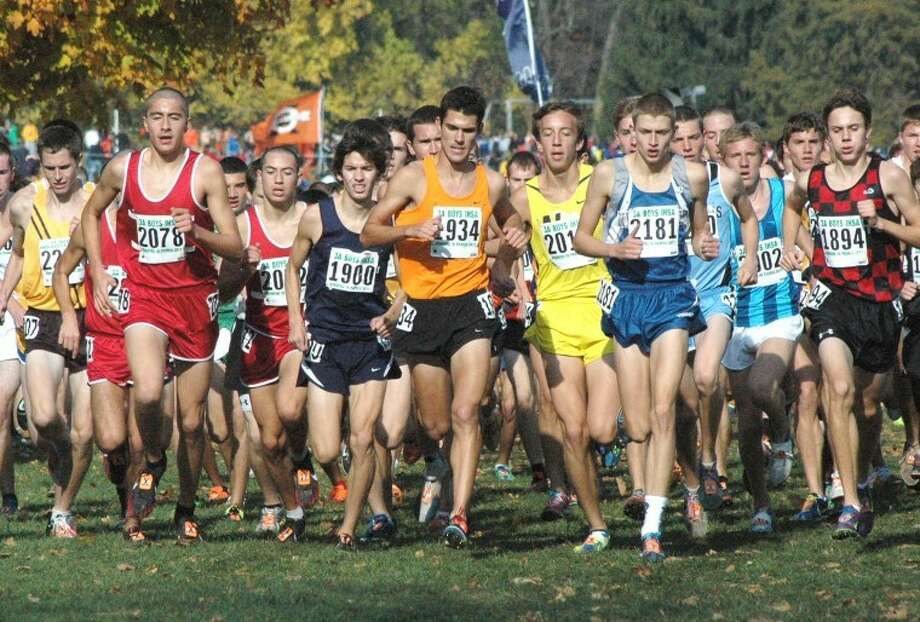 Edwardsville's Garrett Sweatt (1934) leads the pack at the Class 3A state meet on Nov. 5 in Peoria.