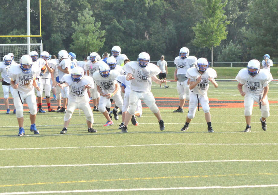 The Liberty Panther eighth grade football team gets off the  line of scrimmage during the orange and black scrimmage Friday at the District 7 Sports Complex.