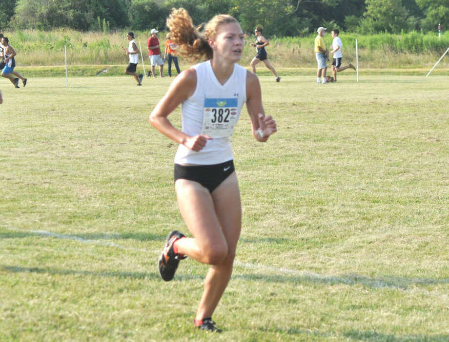 Edwardsville's Allie Sweatt runs the midway point of the Mud Mountain race Saturday at the SIUE course. Sweatt won the women's portion of the race for the third straight year.