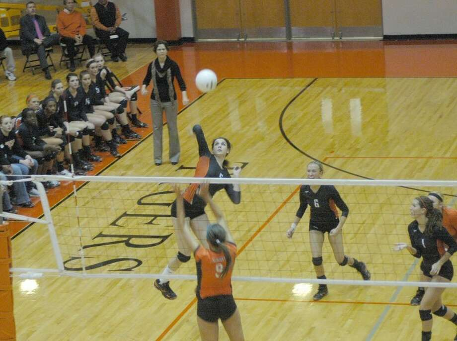 Edwardsville's Sarah Parker attempts a spike during the first game against Minooka in the Class 4A Edwardsville Sectional finals.