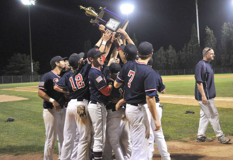 The Edwardsville Metro-East Bears celebrate with their District 22 championship trophy on July 16 at Lloyd Hopkins Field inside Gordon Moore Park in Alton. The Bears finished the season at 24-8.