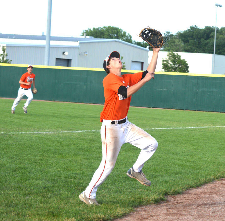 Cole Hansel of the Edwardsville High School summer baseball team catches a pop foul down the first base line during a recent game against the St. Louis Outlaws.