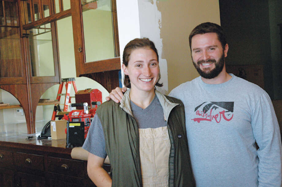 Jennifer Cleveland and Ed Heath stand behind the bar of their restaurant-in-the-making at 106 N. Main St. A late November opening is planned. Photo: Oliver Wiest/Intelligencer