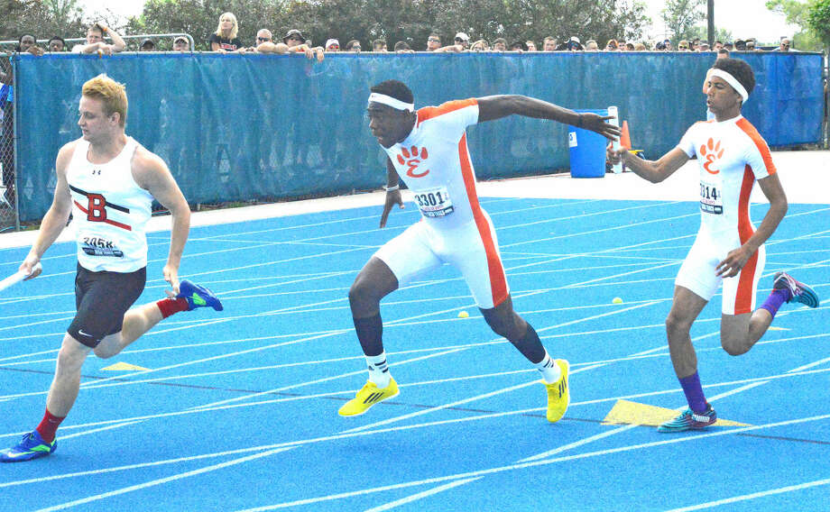 Edwardsville's Fontez Davis, left, takes a handoff from Devonte Tincher in the 400-meter relay at the Class 3A state meet. Davis ran on three medal-winning relays and was first in the long jump.