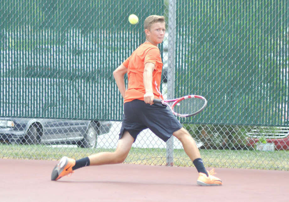 Edwardsville's Jack Desse hits a backhand return vs. Jean Daniel Kehyayan in Monday's Little Wild Card Tournament at the EHS Tennis Center.