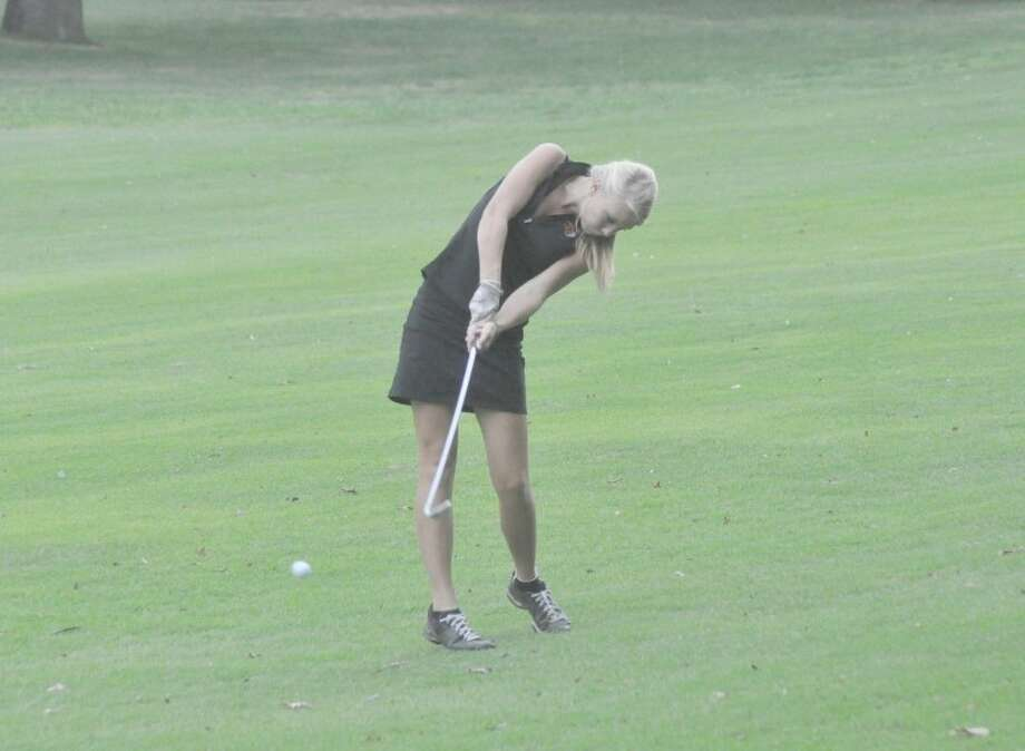 Edwardsville's Lauran Belling hits her iron shot on hole No. 25 on Oak Brook Golf Club's east nine on Monday.