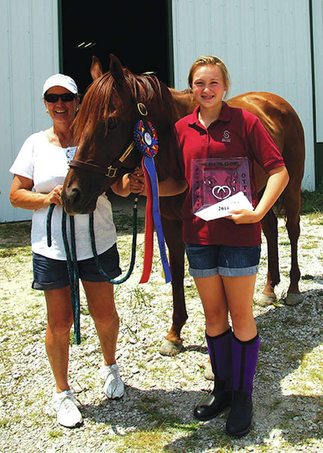 Mad Mad Skillz and rider Delaney Toensing, currently in first place in the Super Award standings, receiving their high point TB awards at the July 19th show at Phancy Pharm. Also pictured is Delaney's mother, Darla Toensing. Photo: For The Intelligencer