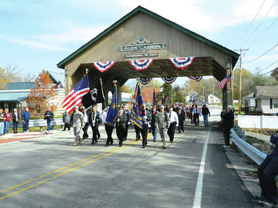 The colors emerge from under Glen Carbon's Covered Bridge Sunday as they make their way to the Glen Carbon Veterans Monument. Photo: Bill Tucker/Intelligencer