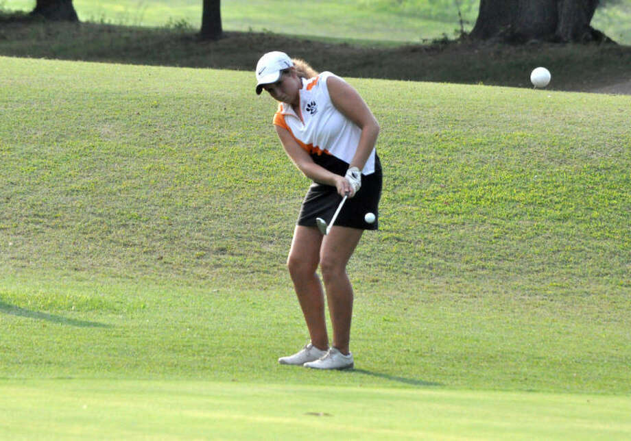 Edwardsville senior Emilee Flaugher chips in for birdie on Hole No. 26 on the east nine at Oak Brook Golf Club. It was one of five birdies during the nine-hole round that set a program scoring record with a 31.