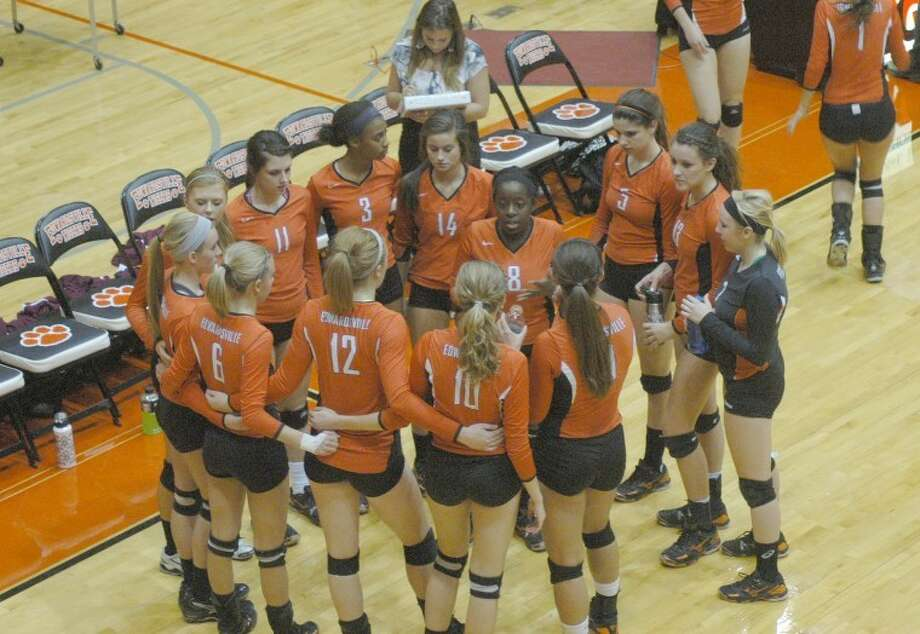 Tiger Mackeznie Collins, center, tries to fire up her team after a loss to Belleville West in the first game of the Class 4A Edwardsville Sectional semifinals. EHS finished the season 34-6.
