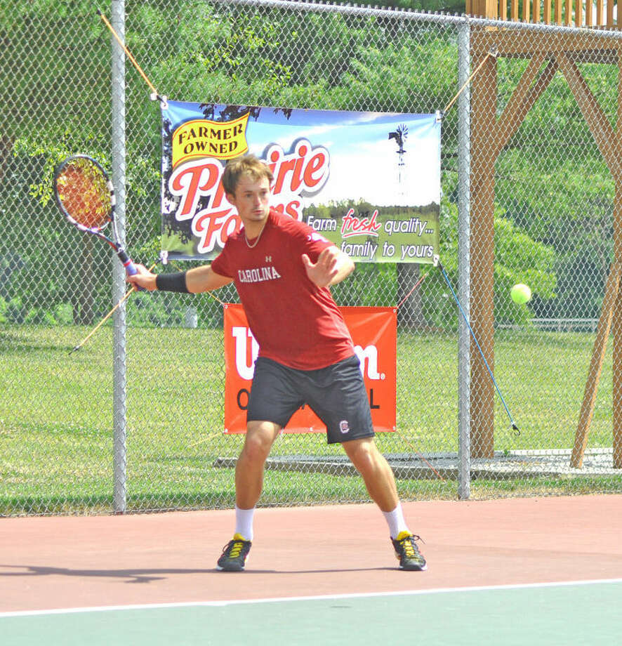 Kyle Koch, who will be a senior at South Carolina, prepares to hit a forehand during Wednesday's title match against Alex Gornet in the Little Wild Card at the EHS Tennis Center.