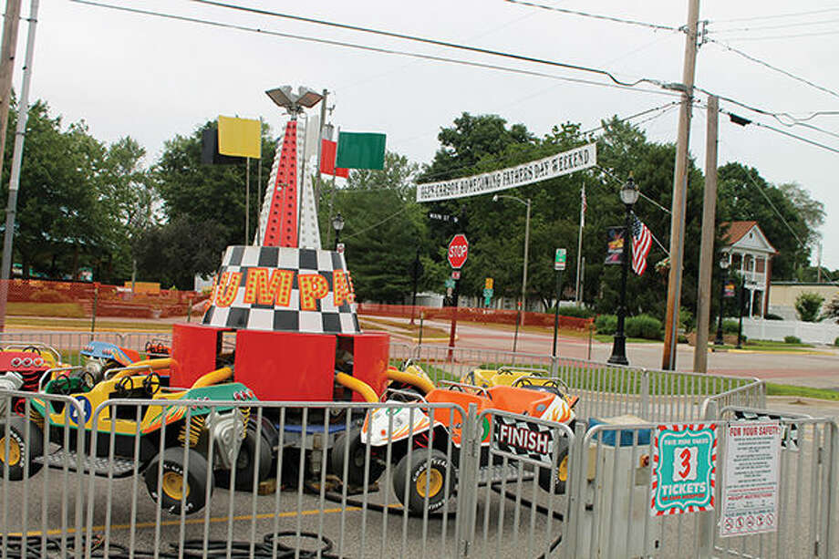 Carnival rides have been put in place as Glen Carbon prepares for its annual Homecoming, which is conducted annually in Old Town. The event runs from 5 p.m. to midnight Friday and from 4 p.m. to midnight Saturday with fireworks at 10 p.m. both nights. Main Street will be closed to traffic through Old Town. Music, rides, games, food and a host of other activities have been planned. Photo: Bill Tucker/Intelligencer