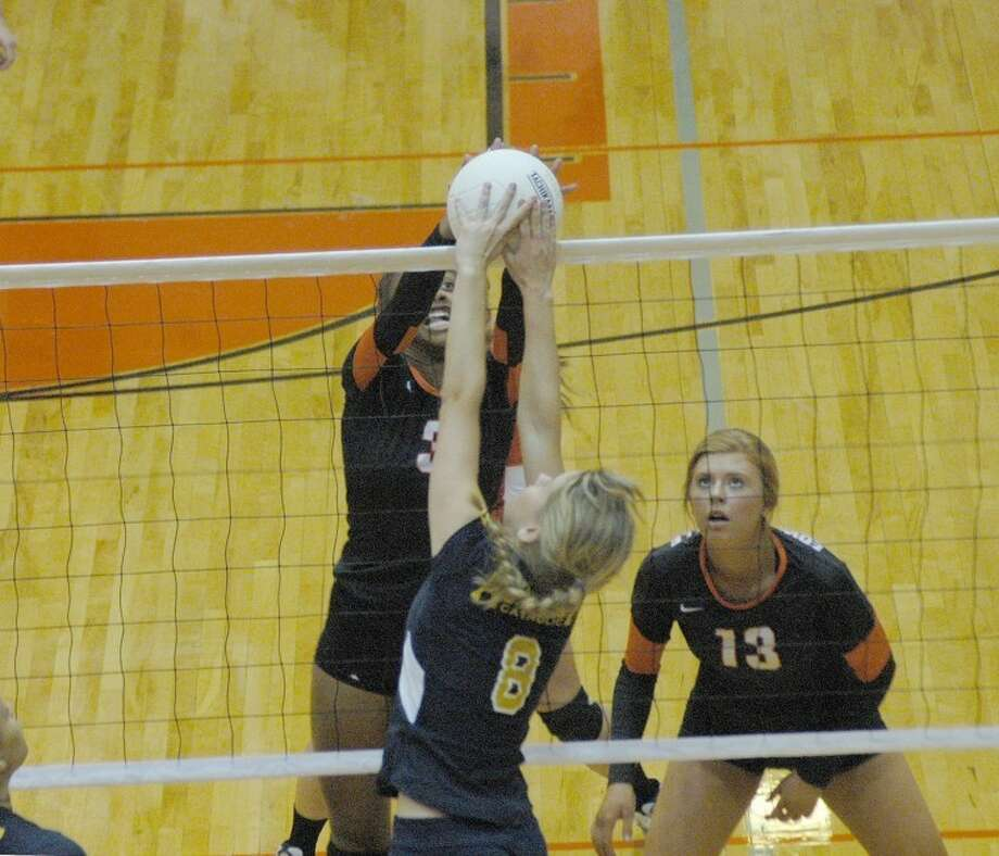 Edwardsville's Lynsey Wright stuffs an Althoff hitter at the net during the first set on Tuesday at Lucco-Jackson Gymnasium.