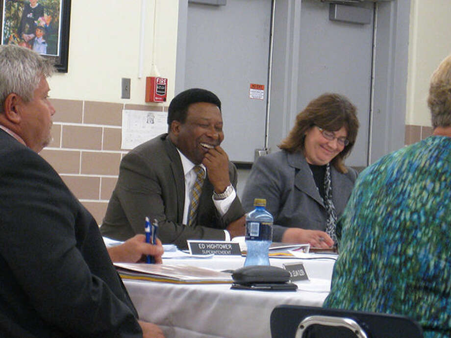 Edwardsville District 7 Superintendent Ed Hightower laughs while being honored at Monday's board of education meeting.