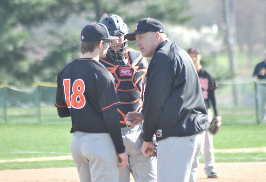 EHS pitching coach Mike Waldo, right, talks with pitcher Daniel Lloyd and catcher Brock Weimer during the 1,000th win he was a part of with the baseball program on April 16 at De Smet Jesuit High School. Photo: For The Intelligencer