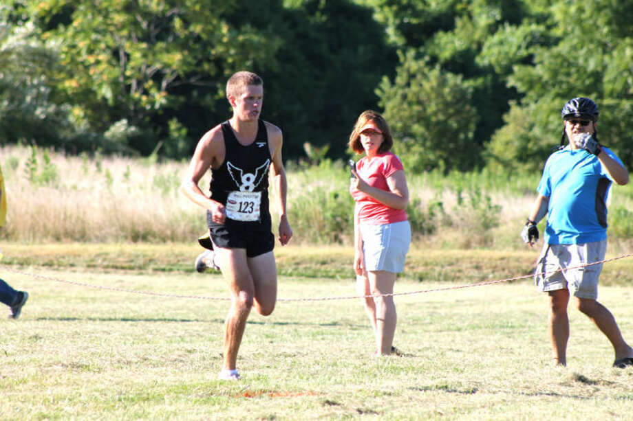 Eric Johannigmeier runs during the 18th Annual Mud Mountain 5K race on the campus of SIUE on Saturday. Johannigmeier was the overall champion for the second time in three years.