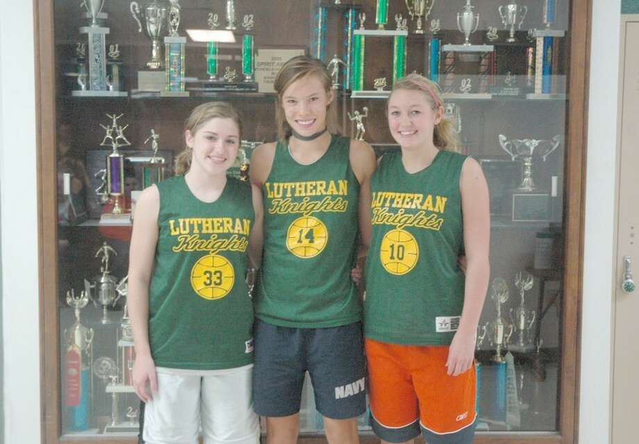 Senior members of the Metro-East Lutheran Knight girls' basketball team from left to right are: Mackenzie Gottlob, Abby Edwards and Molly Scharnhorst.