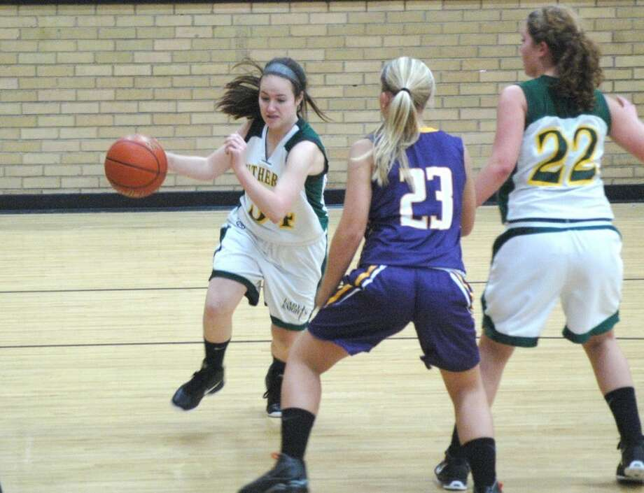 Metro-East Lutheran's Abby McMahon (34) drives the baseline against New Athens Tuesday in opening round action of the Dupo Cat Classic while teammate Lauren Daniels (22) attempts to set a screen. MELHS won 49-14 to advance in the tournament.