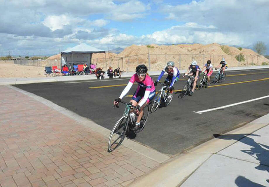 Edwardsville native Jodie Meyers Oates comes around a corner during a 2014 race in Tucson, Ariz. Meyers will be competing in the Stifel Edwardsville Rotary Criterium in memory of her dad who passed away on June 12. Photo: For The Intelligencer