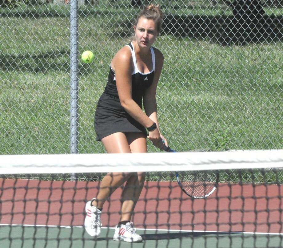 Edwardsville's Paige Bequette hits a backhand return during No. 4 singles action against Quincy on Saturday during the Southern Illinois Duals at the EHS Tennis Center.